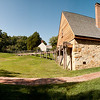 George Washington's Distillery & Gristmill<br /> (the mill building is partially hidden by the trees on the left)