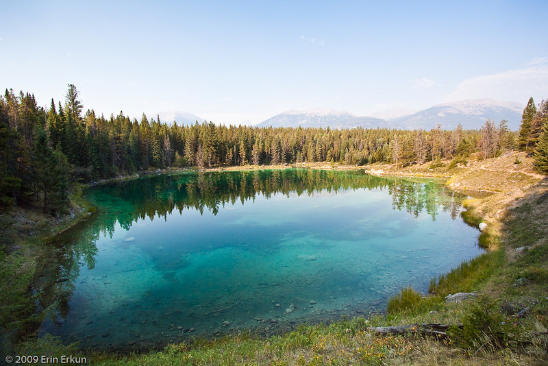 At Fourth Lake, the varying depth of the water creates different shades of blues and greens.