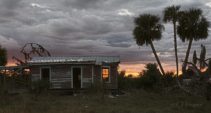 """Old Florida Cracker house at sunset (Kissimmee Prairie Preserve)<br /> <br /> This wooden building is an original Cracker house on a ranch that borders the entrance to Kissimmee Prairie Preserve. The tin roof and the house show hurricane damage.  If you are interested in learning about Florida Crackers, this web page is a good starting point:<br /> <br /> <a href=""""http://homepages.rootsweb.com/~fcc/main/what"""">http://homepages.rootsweb.com/~fcc/main/what</a>'s_a_cracker.htm"""
