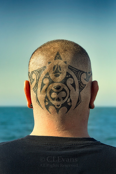 Traditional Polynesian-style Tatoo on the back of shaved head (Clearwater Beach)