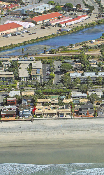 "An aerial view of Del Mar that includes the home at 2808 Ocean Front, which sold for $35 million. The home is at the center bottom with the light-colored roofs and the tennis courts in back. <br><small><B> Photo Courtesy of Kenneth and Gabrielle Adelman </B></small>    <br> <hr width=""250"">"