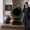 Keith in Les Invalides military museum next to a canon from the 16th century.