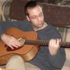Dan plays his guitar