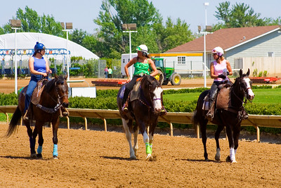 Some women roam around the track between races at Stampede park