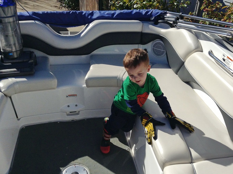 Cameron helping to clean the boat on a warm Feb 18, 2013 day. We took the boat out on the lake that day.