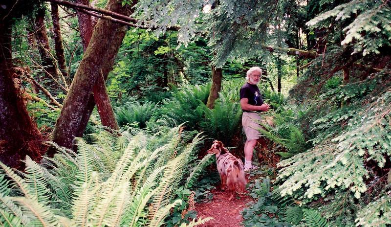 Bruce Barnbalm walking his dog behind his house..