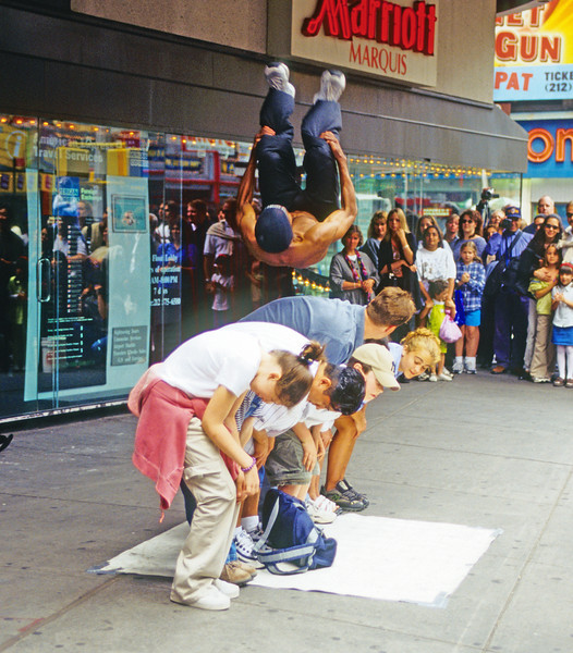Entertainers hawking on the streets in NYC near Times Square.