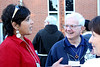 Lois Harrison of Sacred Heart Southern Missions visits with Fr. Paul Casper.