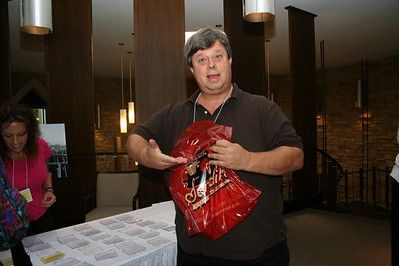 John Kuxhause, province accountant, shows how nice a donated grocery bag looks when it is filled with conference goodies.