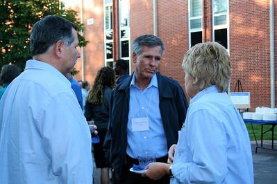 Fr. Raul Gomez, Fr. Jim Brackin and Sally Smits.