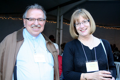 Fr. Yvon Sheehy, SCJ, pastor at St. Martin of Tours parish, and Jeanne Johnson, principal of the parish school.  Jeanne also served on the Mission Education Planning Committee.