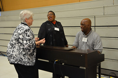 Sr. Emily Morgan, Clara Isom and Orlando Parham share a laugh while preparing for the opening prayer.