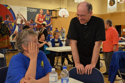 Fr. Stephen Huffstetter, SCJ, executive director of St. Joe's, talks with an employee during a break.