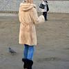 Women in a fur coat on the Vltava River, Prague, Czech Republic in February 2014