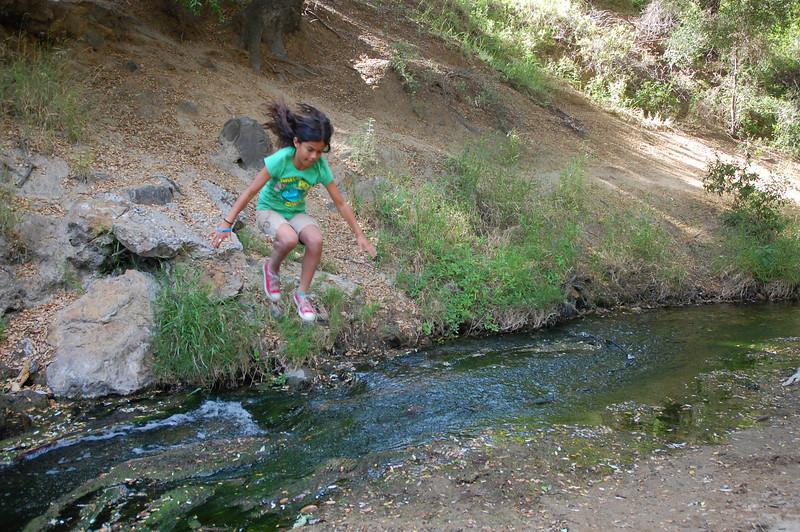 Alana jumps the creek, no problem. Super girl!