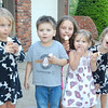 The five cousins enjoying ice cream cones after dinner