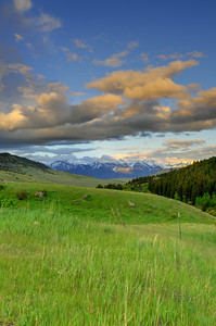 A Montana sunset with  the Absaroka Beartooth Mountains. This is an HDR image captured using 9 different photographs merged together. Photography by Jim R Harris Bozeman Montana Photographer