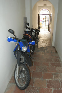 Bikes tucked away in corridor of hostel after pushing them through the old town.