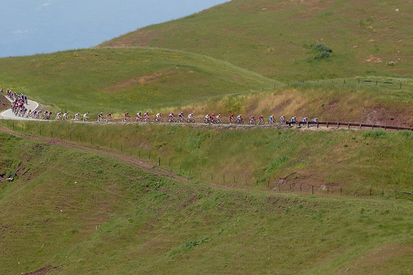 The peloton stretches out along the descent after the Sierra road climb.