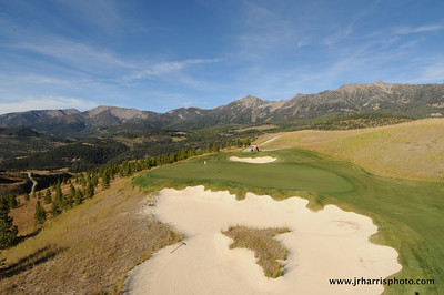 Elevated photo looking over the sand trap to the green