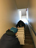 Jarrid and Pauline Sackaney taking files down back stairs in Moose Factory