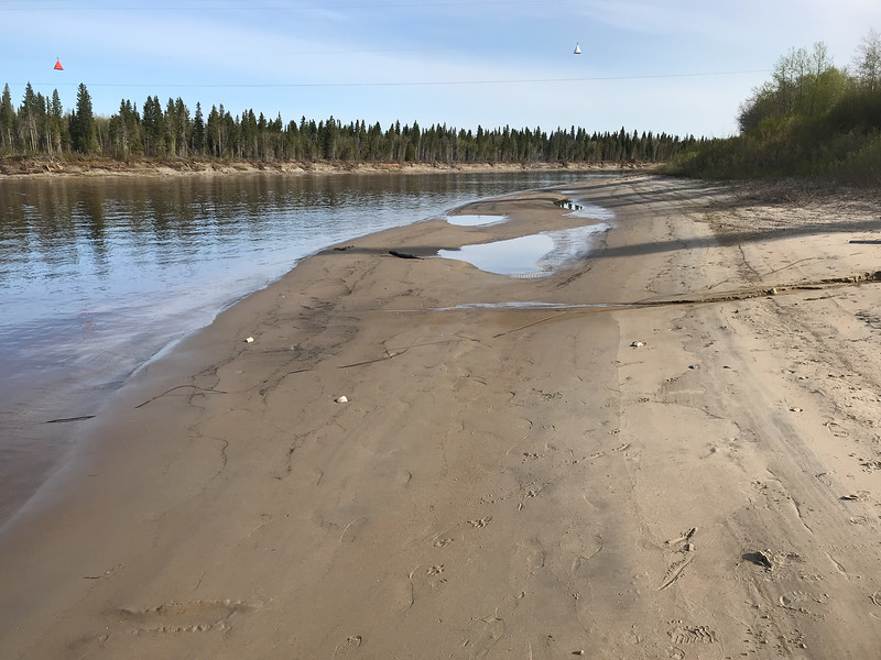 Beach in Moose Factory down from docks