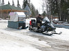 Donald Weapenicappo operating a skidoo taxi in Moose Factory 2007 April 15th.