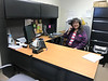 Denise Lantz at desk in Moose Factory satellite office of Keewaytinok Native Legal Services.