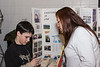 David Hunter interviewing Jessie Sutherland at Career Day in Moose Factory 2006 February 22. Jessie, from Fort Albany, was presenting on behalf of Trent University. David, a grade six student at Bishop Belleau School in Moosonee, was working on a school project about careers.