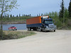 Truck and trailer in Moose Factory driving up from barge landing