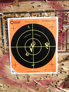 """Shot at some """"paper"""" for the last group.  Fourth five-shot group at two hundred yards.  Two in the Bulls Eye with another touching the ring (counts)..."""