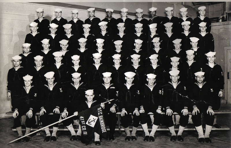 USNTC BAINBRIDGE Recruit Company 41(R) - 1953 Photo.<br /> <br /> 1953 Graduation Photo of Company 41(R) was submitted by Jacob Morente whose father Edward S. Morente III is in the third row - fourth from the right.   <br /> <br /> He served as USNR from September 23, 1952 to February 24, 1957.<br /> <br /> Here are names of classmates from my father's RTC Company 41st (R).<br /> I've deciphered the spellings the best that I can - many were signatures. Thank you again, Jake Morente<br /> <br /> (Names are in no specific order - 29 are listed out of a Company of 52 Recruits).  <br /> <br /> If you can identify any of the members or have more information on Company 41(R) in 1953, please e-mail me (Tony Lupacchino), or click on ADD COMMENT button and leave whatever information you can provide.<br /> <br /> <br /> Buddy Jackson; Jim Woerner; Buddy Ward; Edward J. Geary; Harry Shropshire; Anthony B. DiViesli; John Lieb; <br /> James Bonora; Robert A. Manning; Mike Fleming; Jim Golden; John G. Sedlock; John Engel; Paul Hoffman;<br /> Larry Lanuti; Richard W. Tompkins; Wilton Black; Dick Puvowarski; Charles S. French, III; Jim L. Woerner;<br /> Thomas Civera, Jr.; Jean Ginhler, Jr.; Paul Allen, Jr.; Charles J. Warner, Jr.; Johnny Fincion; Dick Whittaker;<br /> Harry Nordling, Jr.; Thomas Ciehinski