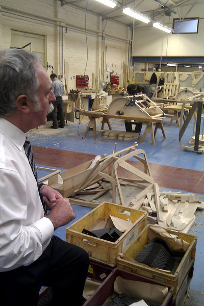 Robert, our guide, shows us where the ash frames are built - the machined wood smells wonderful.