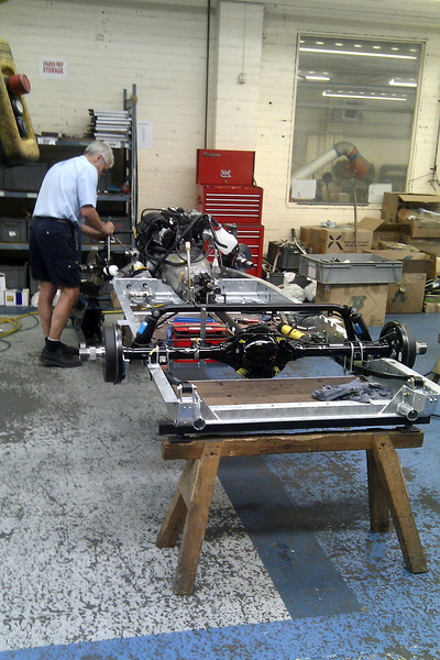 One man is responsible for constructing one car chassis.   There are up to 10 in production here at any one time.