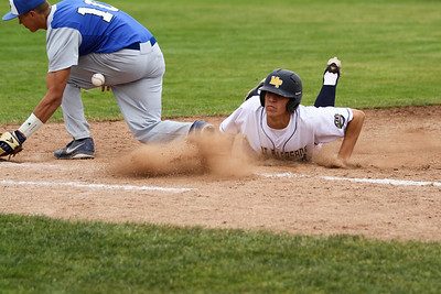 Ken Kadwell/@KenKadwell - Special to the Sun Mt. Pleasant Oiler's Zach Heeke (20) dives safely back to first base against Gladwin in the MHSAA Division 2 Baseball Quarterfinal at Theunissen Stadium in Mt. Pleasant Tuesday, June 10, 2014.  Final score 5-0 Mt. Pleasant.