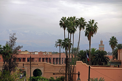 the faint atlas mountains looming over marrakech