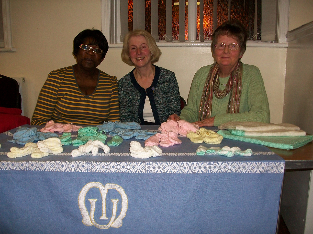 Enrollment Officer of the Mothers' Union Kathy Nurse with Linda Barron & Jean Rothwell knitters for the premature babies at Bolton Hospital