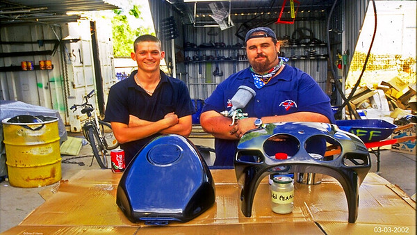 Aaron Francis & Anthony (both Buffalo Bolt Co staffers) almost finished yet another pro quality DIY paint job on the motorcycle tank & fairing. Two part paint & gravity spray gun.