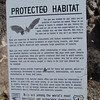 Higher on the hill, the other end of the tunnel, also bat gated, has a protected habitat sign.