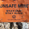 Unsafe.  Rattlesnakes, loose rock, falls, rotten timbers, explosives....