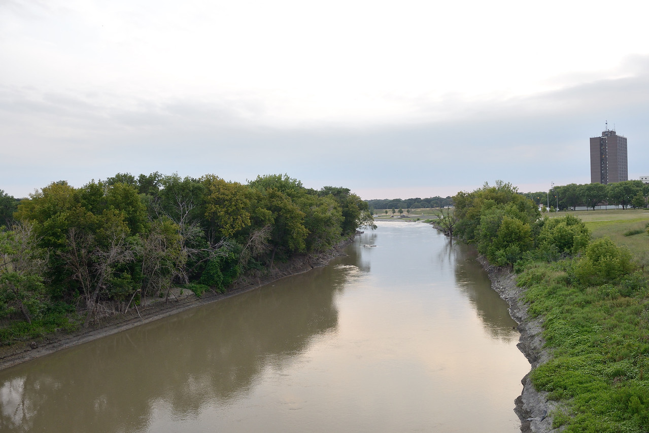 Looking south and down onto the Red River from The Vetrans Memorial Bridge between Moorhead MN and Fargo ND.  Quite suprisingly this river much like Yellowstone River flows North.