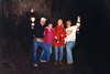 """HAPPY SPELUNKERS<br /> Here are me, Joyce, Heidi and Jack with lanterns hoisted high. It really was an incredible experience, especially given the method of creation of this cave. It always left me wondering, """"What if . . . ?"""""""
