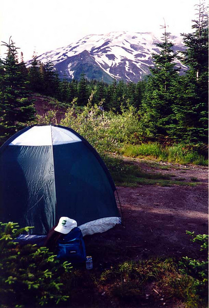 """AT THE CLIMBER'S BIVOUAC<br /> The Climber's Bivouac was a small campground set aside specifically for Mt St Helens climbers. If you didn't have your registration form displayed, you got a ticket. This is my old dome tent -- called the """"Texas Tent"""" by my co-workers -- and gear with Mt St Helens herself in the background. Mt St Helens is always referred to in the feminine due to its role as a beautiful maiden in Native American folklore. Her suitors, who were banished due to their constant fighting over her, became Mt Adams to the north here in Washington, and Mt Hood to the south in Oregon."""