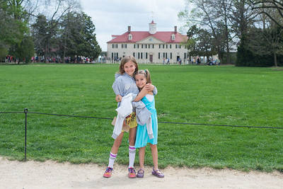 E and C in front of the mansion.