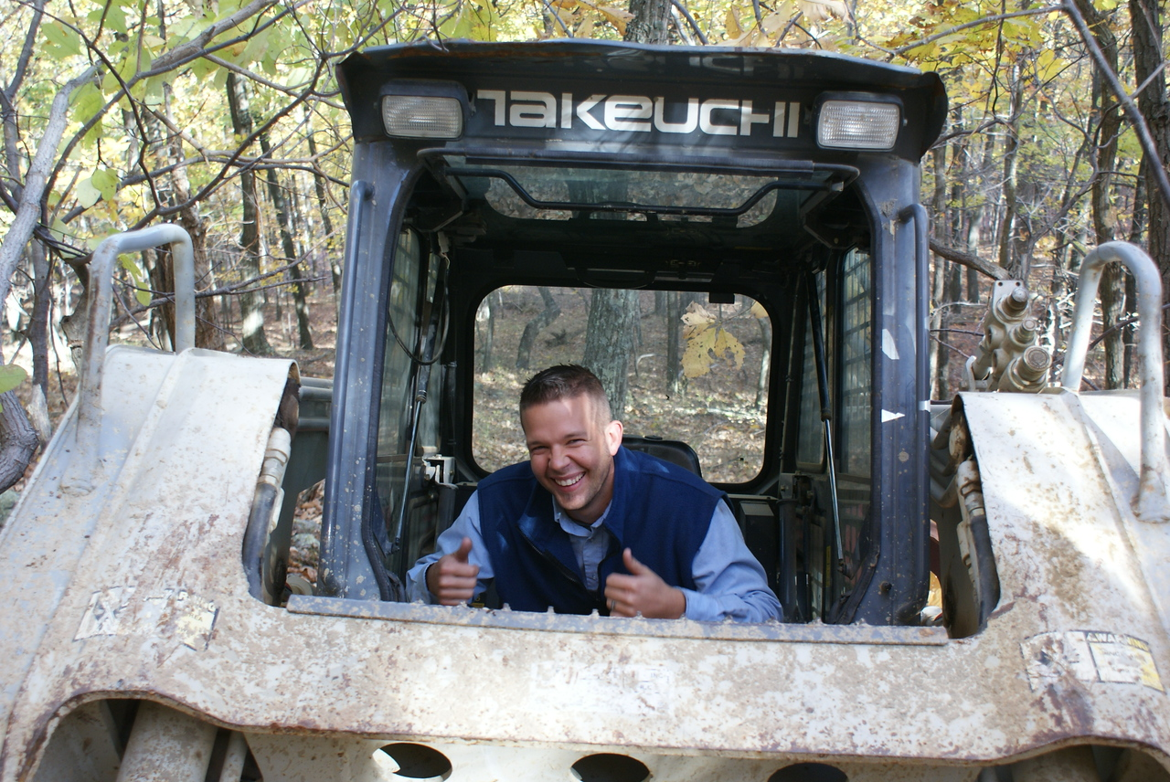 That's Cory, the Rentals Unlimited Sales Rep. He took over the bobcat getting it out of the woods.  Mr. Hotshot lost the other track on the way out of the woods.  So it wasn't just me…