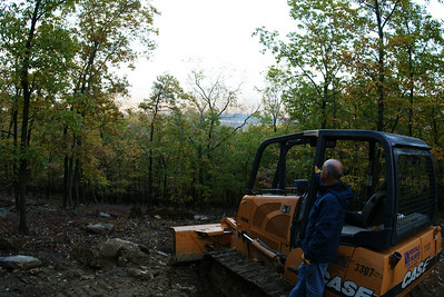 Dad standing on the dozer enjoying the view.