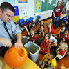 Globe/T. Rob Brown<br /> Dr. C.J. Huff, superintendent of the Joplin R-8 School District, carves a pumpkin for Melissa Thompson's kindergarten class at West Central Elementary School Wednesday morning, Oct. 24, 2012.