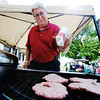 Globe/T. Rob Brown<br /> Larry Dahnke, of Joplin, husband of a Schifferdecker Women's Golf member, helps the women's group with a fundraiser by grilling burgers Saturday afternoon, July 14, 2012, outside the club house during the Ozark Amateur at Schifferdecker Golf Course. In the past, funds have gone toward buying the club a computer, furniture, tee holders, T-shirts, and donations to junior golf, the breast cancer tournament and the Blind Association.