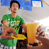 Globe/T. Rob Brown<br /> Anh Bui, 20, of Our Lady of Vietnam in Amarillo, Texas, takes a customer's ticket as he hands them a cantaloupe variety of bubble tea during Thursday afternoon's heat, Aug. 2, 2012, at Marian Days in Carthage.
