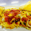 Globe/T. Rob Brown<br /> The Monster Mess topped with picante sauce by Ge Xiong, owner of New Day Cafe in Joplin. The Monster Mess includes eggs, hasbrowns and cheese plus a mix of mushrooms, onions, tomatoes, sausage and ham.